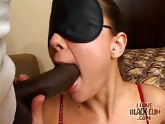 Cute brunette sucks sensually on black cock tubes