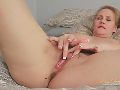 Milf chats and strips from lingerie to rub tubes