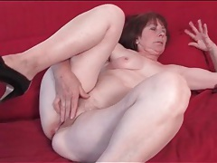 Sexy solo grandma masturbates her cunt tubes