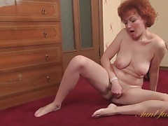 Shaved mature redhead rubs her cunt tubes