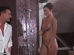 Petite girl showers and fools around with her man tubes