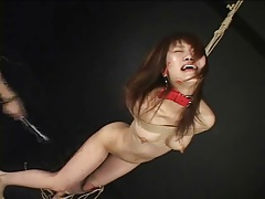 Japanese girl in pain from flogging tubes