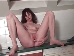 Sexy old lady pleasures her pussy tubes