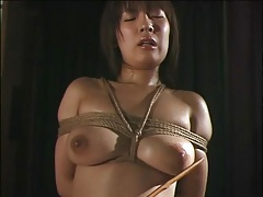 Wet japanese girl tied up by rope tubes