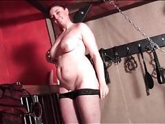 Curvy milf masturbates in her dungeon tubes