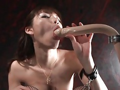 Submissive japanese girl sucks a dildo tubes