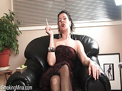 Dirty talking milf strips and smokes cigarette tubes