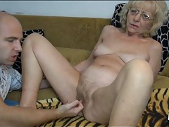 Granny in glasses fingered in her pussy tubes
