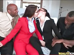Girls in suits kiss lustily and suck black cock tubes