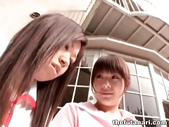 Cute asians fool around outdoors tubes