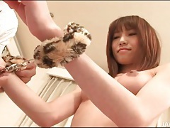 Leather boots japanese girl in handcuffs tubes