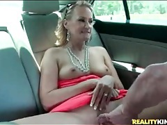 Blonde milf shows tits and cunt in the car tubes