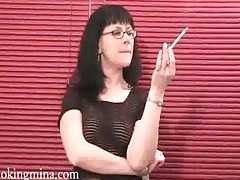 Smoking brunette in sexy pair of glasses tubes