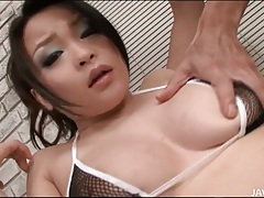 Japanese cutie in fishnet bikini fondled tubes