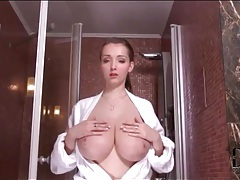 Cutie opens her robe and models big tits tubes