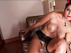 Busty babe in red lipstick finger fucks tubes