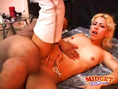 Lucky midget fucks blonde girl in boots tubes