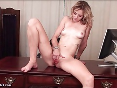 Naked blonde beauty masturbates on desk tubes