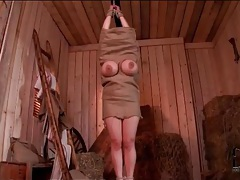 Guys fondle a girl in a burlap sack tubes