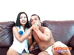 Cute slut blows a black midget tubes