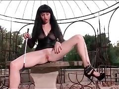 Brunette in black leather masturbates outdoors tubes