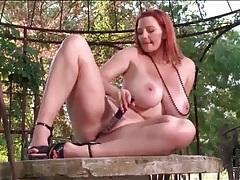 Curvy redhead fucks her dildo outdoors tubes