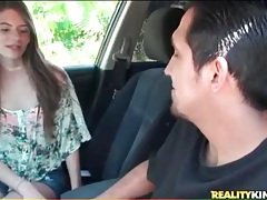Sweet brunette teen blows him in the car tubes