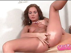 Hottie with wavy hair fingers her wet pussy tubes