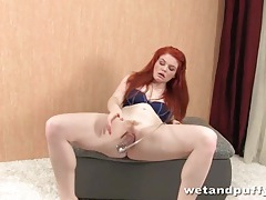 Redhead plays with toys in close up tubes