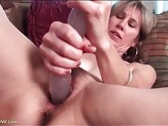 Hairy milf moans as she fucks thick dildo tubes
