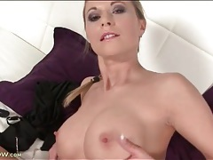 Milf has a pair of sexy and firm fake titties tubes