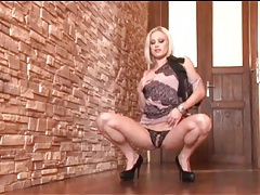 Blonde in a sexy outfit strips in tease video tubes