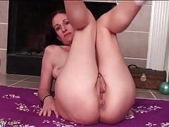 Naked milf bends flexible body on floor tubes
