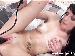 Pierced girl masturbates with black dildo tubes