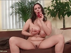 Voluptuous brunette fucks pussy with a toy tubes