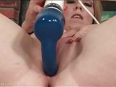 Chubby milf masturbates her pussy with a toy tubes