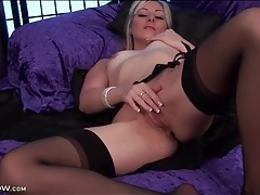 Blonde milf erotically rubs her shaved pussy tubes