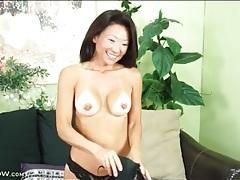 Cute asian milf smiles during sexy striptease tubes