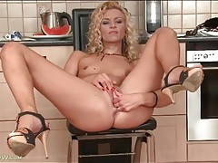 Hottie with curly hair masturbates her cunt tubes