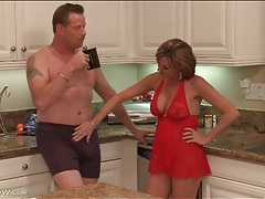 Housewife in lingerie blows her man in kitchen tubes