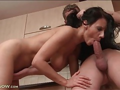 Cock craving brunette slobbers on cock in kitchen tubes