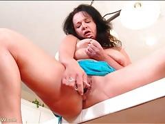 Big tits mature fucks cunt with dildo tubes