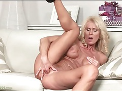 Blonde mature with fake tits fingers her pussy tubes
