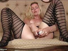 Striped stockings look sexy on masturbating milf tubes