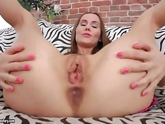Young pussy gets all wet as she fingers tubes