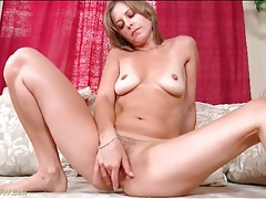 Tasty milf with tan lines fondles her body tubes