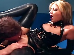 Blonde in a uniform and latex lingerie fucking tubes