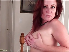 Irresistible milf redhead teases in lingerie tubes