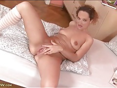 Solo girl strips to socks and fingers pussy tubes