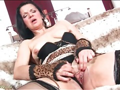 Dark haired mature masturbates in lingerie tubes